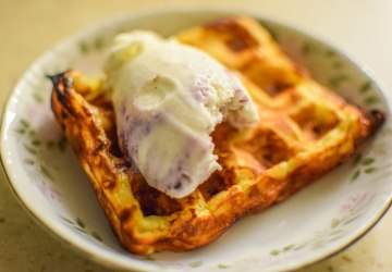 Blueberry-Peach Ice Cream atop apple cheddar waffle