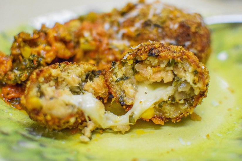 Corn and Swiss Chard Arancini Stuffed with Mozzarella, Italian Sausage and RapiniRagu